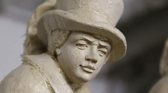 Geschnitztes Gesicht Mann mit Hut